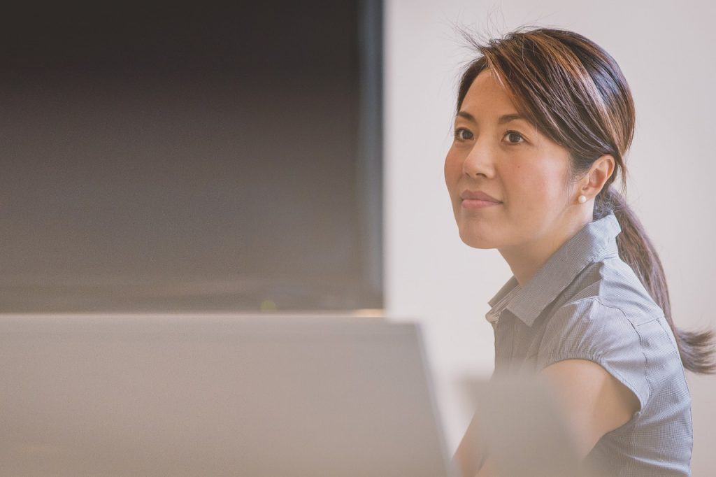 Photo of an Asian female professional in the office