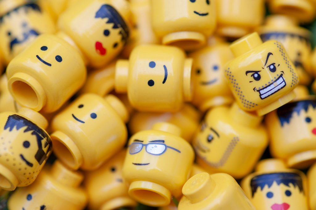Lego heads with different attitudes and faces