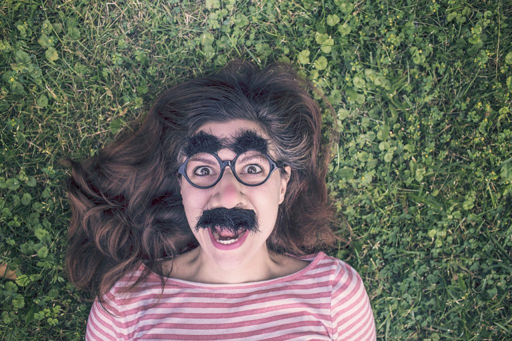 Magazine content strategy: Woman wears Groucho Marx glasses to demonstrate consistent cross-channel branding
