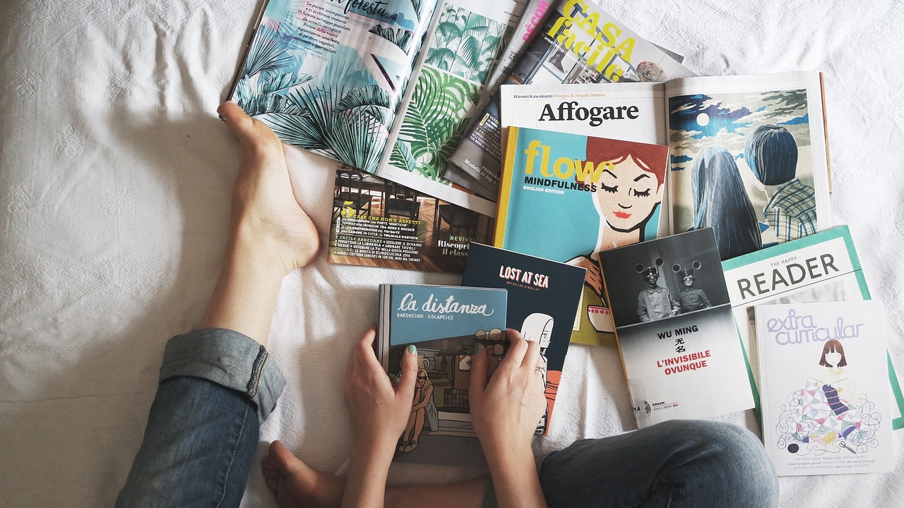 Print magazines strewn over a teenager's bed