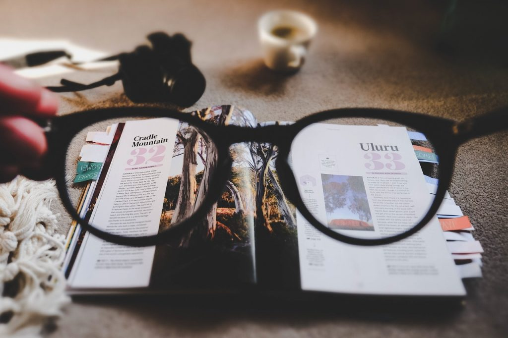 Magazine's layout under a pair of designer glasses