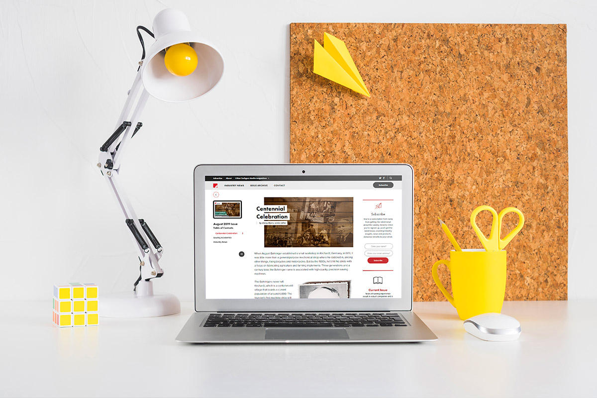 Industrial website design displayed on a laptop