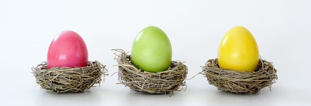 Colored eggs in nests (symbolizing figurative shapes in relation to brochure design)